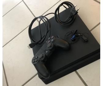 PS4 slim 1 TO avec 5 jeux offerts 1